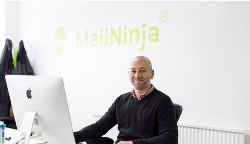 Doug Dennison sat down smiling at MailNinja HQ